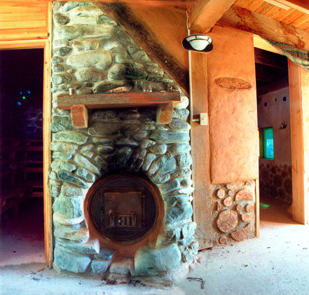 2. Sauna Hearth(A stone hearth holds a barrel stove that heats the sauna and produces hot water)