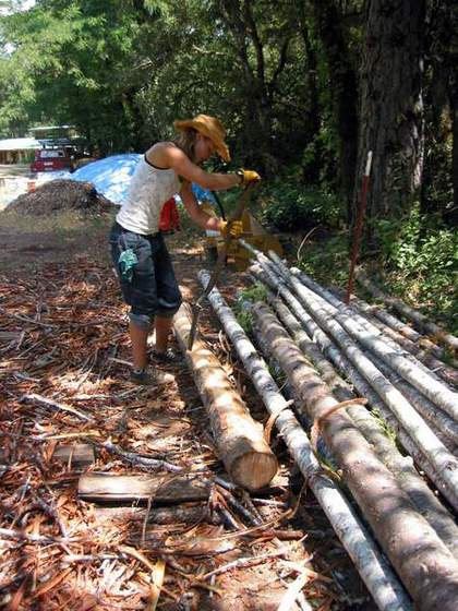 Fir Poles for Natural Building (Darien peels poles for our cabana)