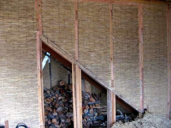 Reed Mat for Slipstraw (Reed mat has become a popular natural buildikng material, here it's used as a form for slipstraw, providing an excellent surface for earth plaster)